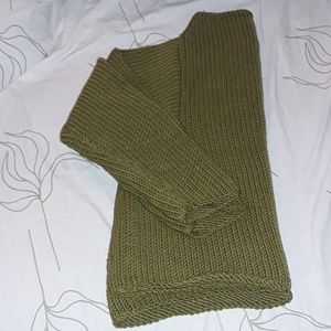 Ball of cotton warm green sweater